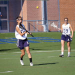 lacrosse player throwing ball